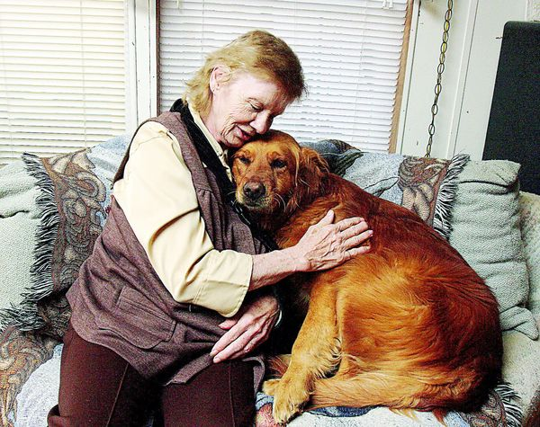 Joyce Miller and her new Golden Retriever Joy